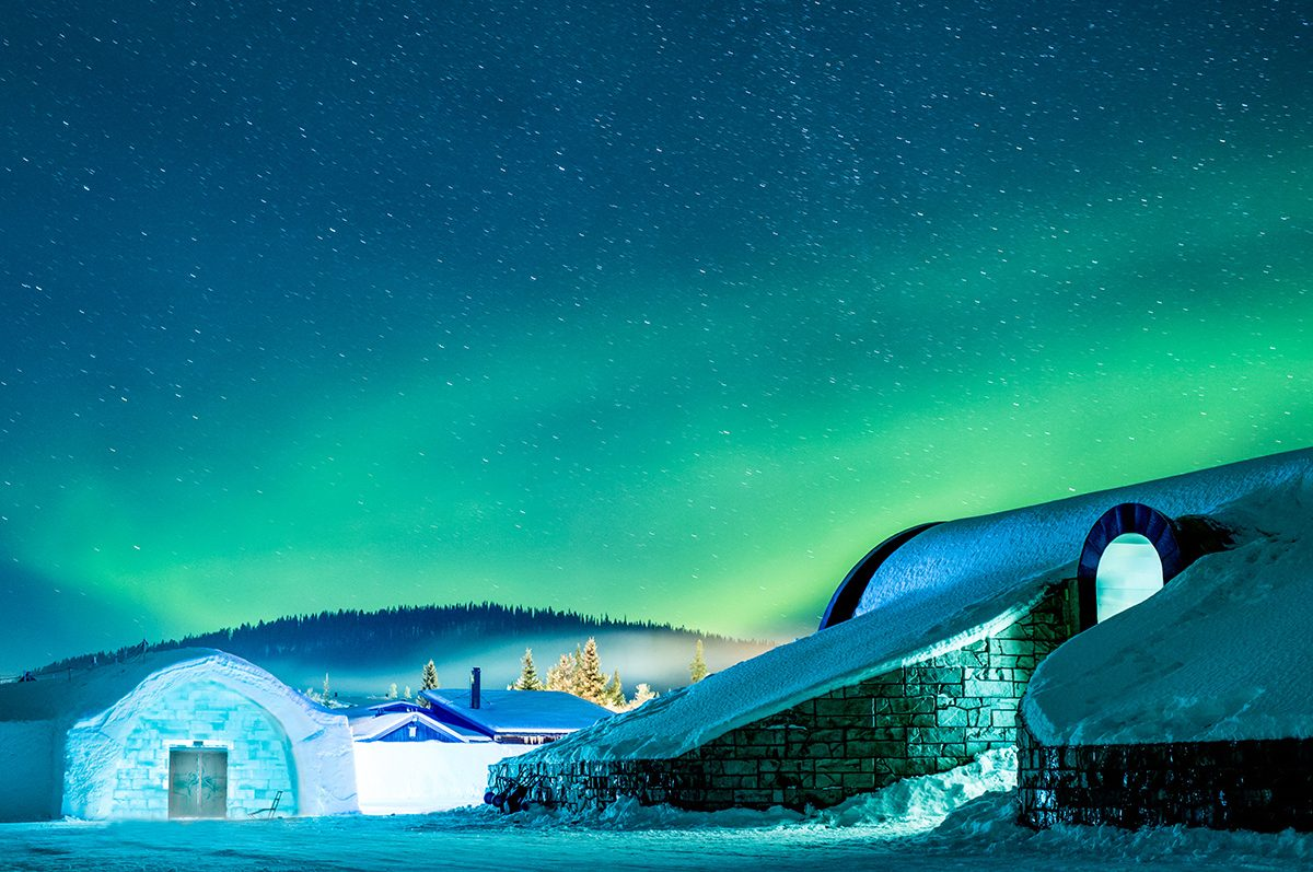 At the Ice Hotel, guests can enjoy the Northern Lights, sleep on stunning, hand-sculpted artworks, and dine on award-winning meals.
