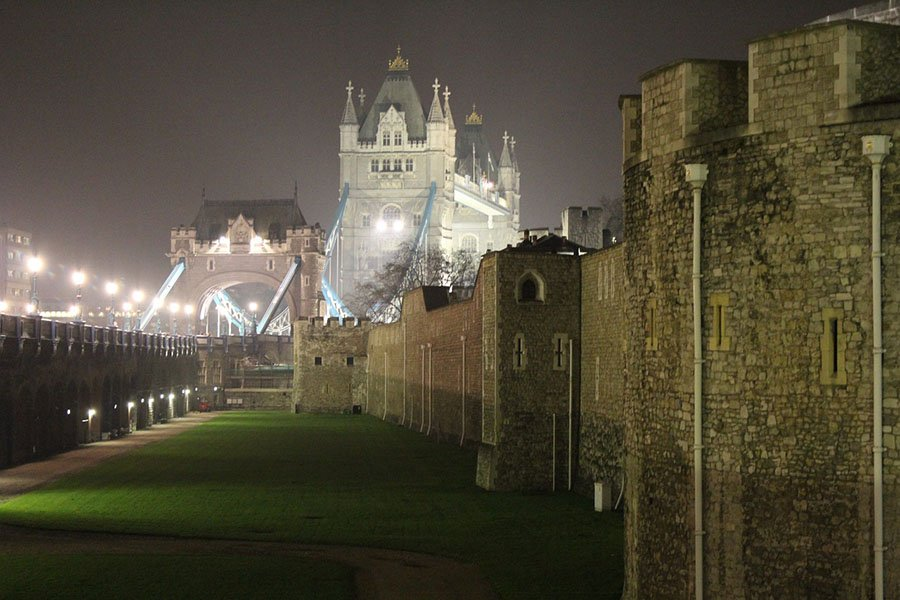 The Tower of London is haunted by a dark history (here the Tower Bridge is shown looming in the background).