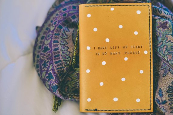 I love the playful designs, the whimsical text, and the hand-stitching that adorns each cover.