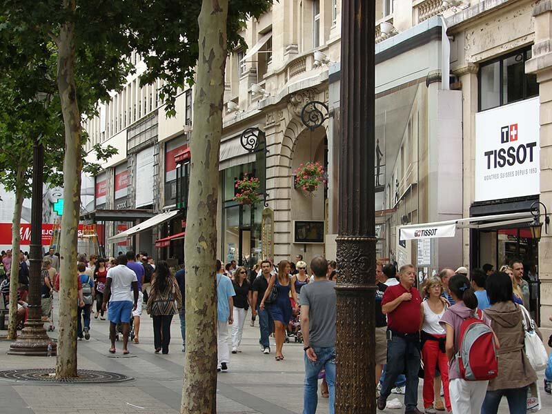 The Champs Élysées is crowded with dealerships, megastores, and touristy cafés